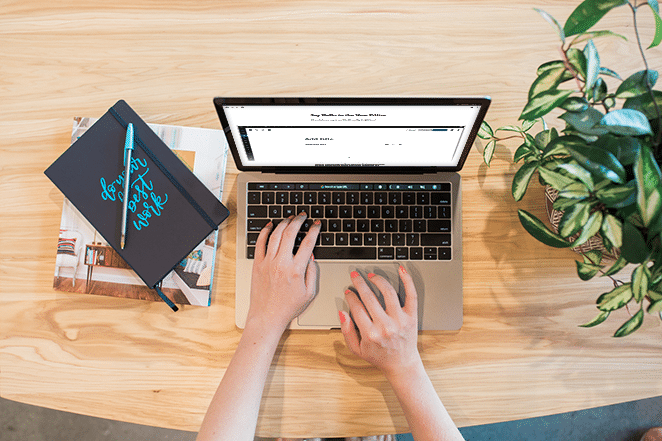 layout by flywheel get ready for gutenberg best wordpress update for content creators laptop with wordpress gutenberg news on screen do your best work notebook and plant on wooden table