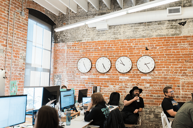 make website load 2 seconds or less clocks on brick wall in flywheel office